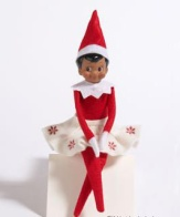 Female Elf on a Shelf in a seated pose